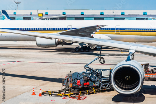 Refueling operation of passenger transport aircraft in the plane parked at the airport Canvas Print