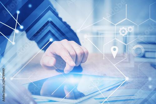 Fotografía  Businessman using tablet with virtual interface