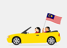 People In Car With Malaysia Flag