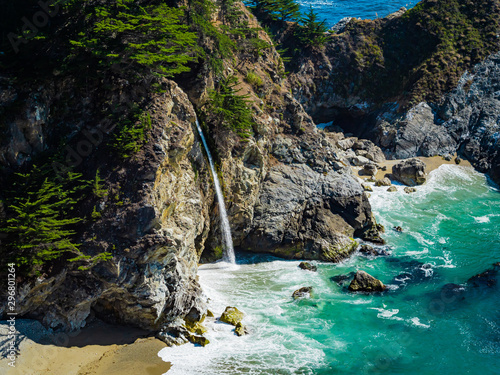 Foto auf Leinwand Wasserfalle Aerial view of Water Fall McWay Falls Julia Pfeiffer Burns Park Big Sur California. McWay Falls a waterfall empties directly into the ocean.
