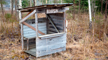 Old Abandoned Kiosk In The Mid...
