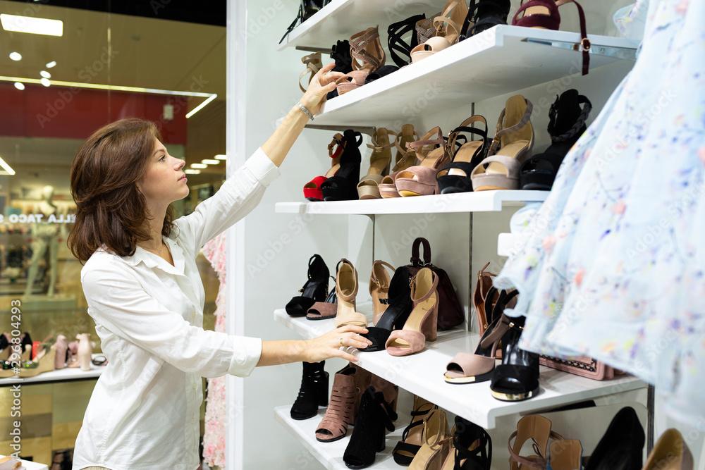 Fototapety, obrazy: Casucasian female in elegant white shirt chooses evening shoes, heels