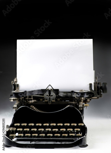 Antique Typewritter with blank paper for your type or text. . Tapéta, Fotótapéta