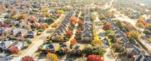 Obraz Aerial view row of new house with cul-de-sac (dead-end) and bright orange color fall foliage near Dallas - fototapety do salonu