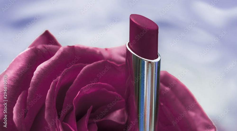Purple lipstick and rose flower on liquid background, waterproof glamour make-up and lip gloss cosmetics product for luxury beauty brand holiday design