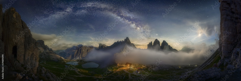 Fototapety, obrazy: Beautiful panoramic shot of a mountain valley with a small illuminated house under the starry sky