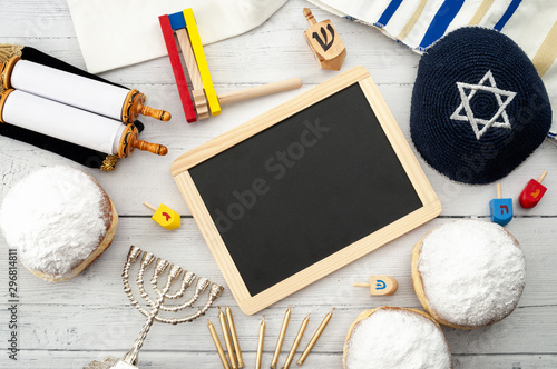 Obraz na plátně Happy Hanukkah - Dreidel (wood spinning top), menorah (traditional candlestick),