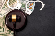 Bail Bond System, Bailing Out Of Jail And Innocent Until Proven Guilty Conceptual Idea With Judge Wooden Gavel, Dollar Banknotes And Handcuffs With Copy Space