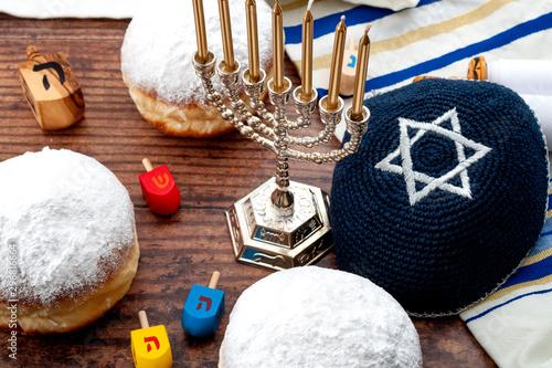 Fotografie, Obraz  Happy Hanukkah - Dreidel (wood spinning top), menorah (traditional candlestick),