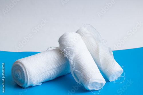 White bandage on a blue background closeup Canvas Print