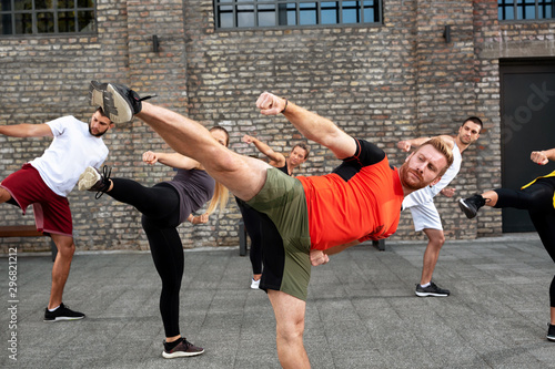Cuadros en Lienzo  Group of people performing leg kicks