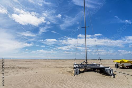 Fototapeta Resting catamaran on IJmuiden Beach (NL)