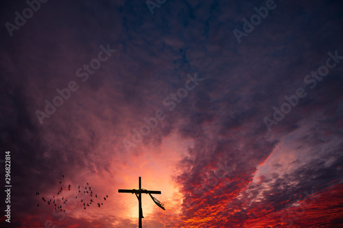 Canvas Print Cross and a dramatic epic sunrise