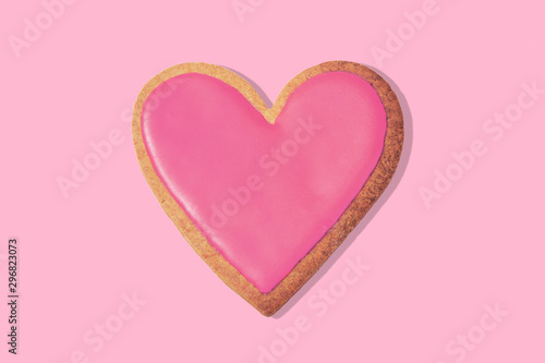 Decorated heart shaped cookie on pink background, top view Canvas Print