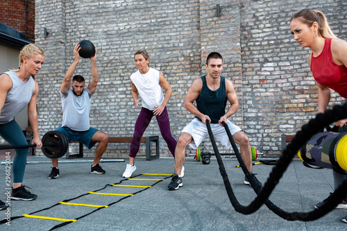 Group training, fitness group, working out together - 296825084