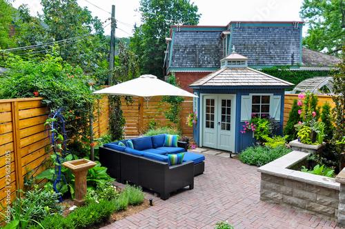 This Beautiful Small Urban Backyard Garden Features A Herringbone