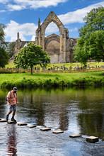 Man Crossing The River Wharfe ...