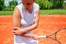 Elbow Injury In Tennis, Unpleasant Facial Expression