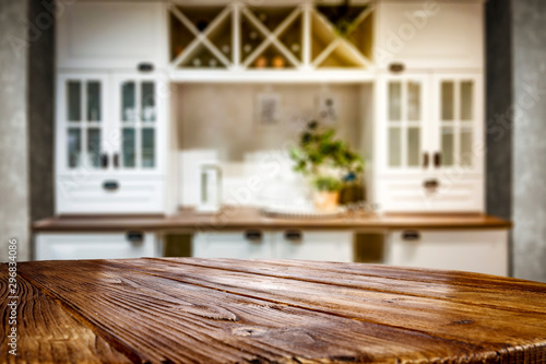 Kitchen table top with empty space for you products or decoration and blurred kitchen furniture background Tablou Canvas