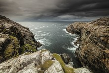 Gloomy Scenery Of Two Mountains Standing In The Ocean In Isle Of Lewis, Outer Hebrides, Scotland, UK