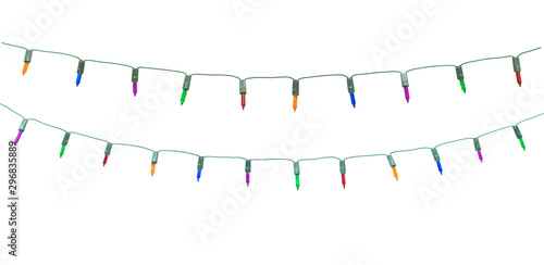 Christmas lights on dark wooden background. Merry Christmas and happy new year with copy space for a text..