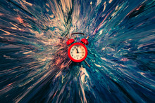 Time Flies. Red Vintage Alarm Clock Falling Down Into Blue And White Paint With Splash Effect. Abstract Art Background.