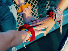 Three Hands With Bracelets Ove...