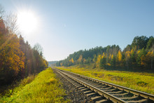 Railway Track In The Autumn Forest.  Railway In The Autumn Evening