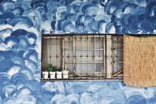 Blue Swirls On Wall With Window
