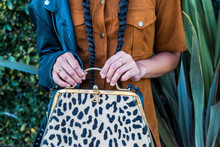 Woman's Hands Holding Leopard Print Purse
