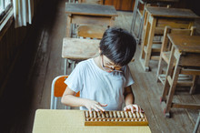 Young Boy Using Abacus