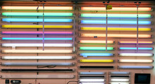 Fluorescent Light Tubes Hanging In Rows On Store Wall