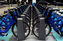A Row Of Blue Bicycles On New York Street. Rent Of Blue Bikes.