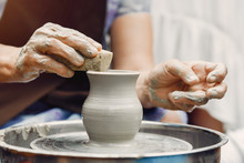 Potter Make A Small Jug. Hands Of A Potter At Work