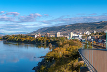 2019-10-03 Kamloops, BC, Canada. Riverside Park. View Of Thompson River, Kamloops Downtown Buildings, Mountains, Trees.