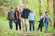 canvas print picture - Big family with many children walking in forest