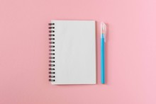 Open Spiral Notepad On A Pink ...