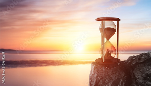 Aluminium Prints Salmon aesthetic hourglass in the beautiful setting sun