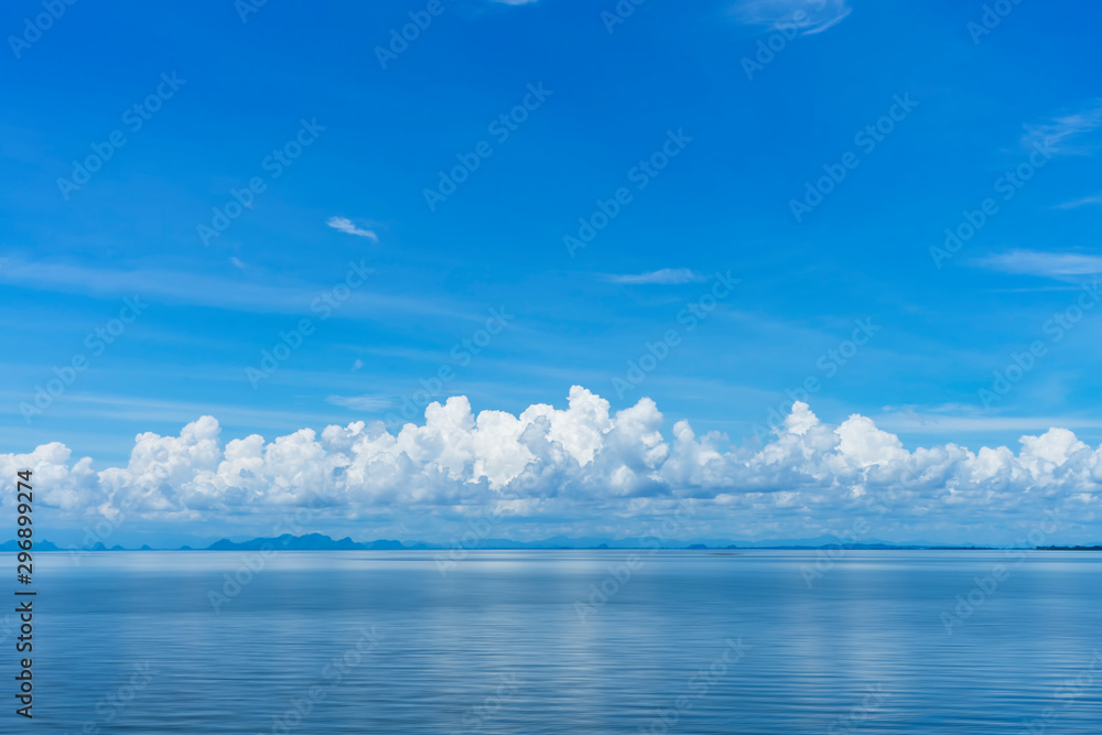 Fototapety, obrazy: Blue sky background with white clouds on the lake.