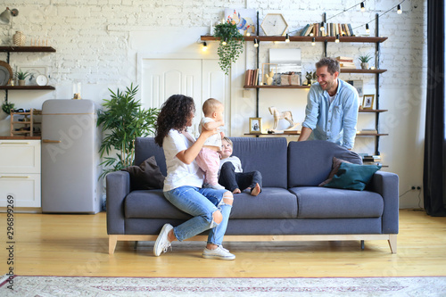 Pinturas sobre lienzo  Young beautiful happy family relaxing at home