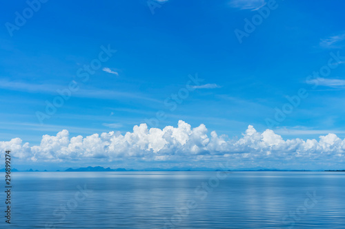 Blue sky background with white clouds on the lake. Canvas Print