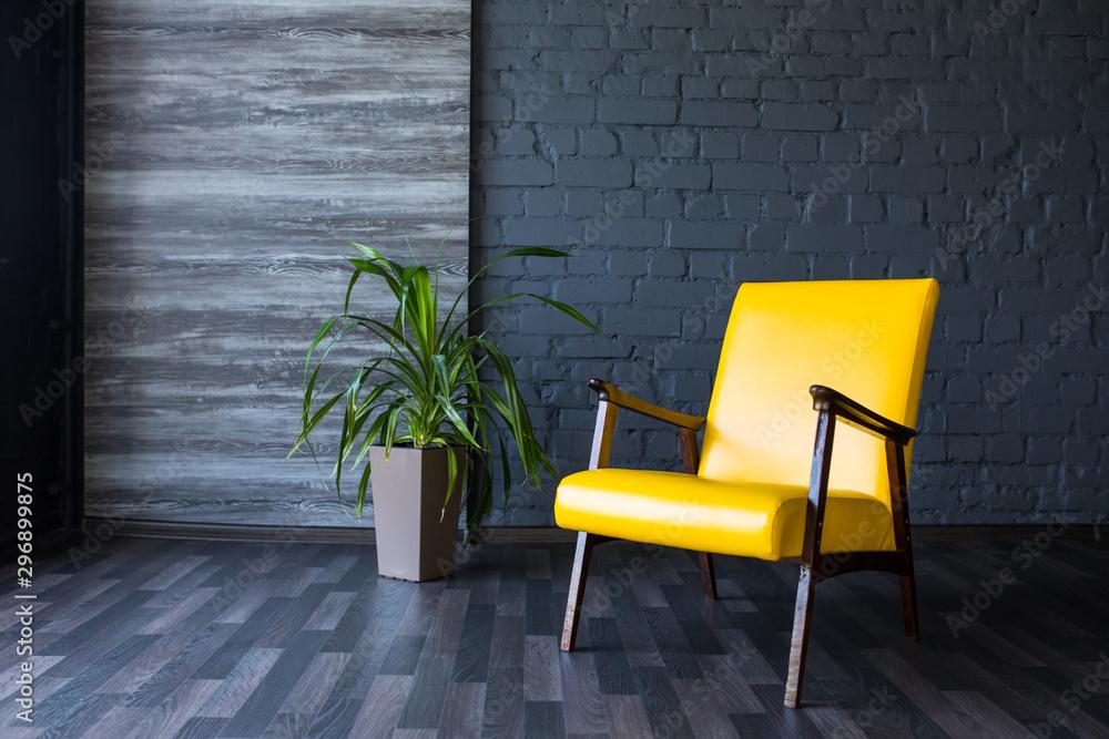 Fototapety, obrazy: Stylish retro yellow chair in the gray room. Brick gray wall. Room.
