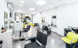 Panorama of a modern bright hair and beauty salon. Barber salon interior business with black and white luxury decor.