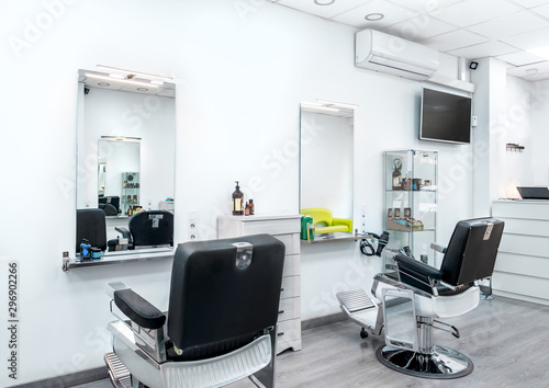Modern bright hair and beauty salon. Barber salon interior business with black and white luxury decor.