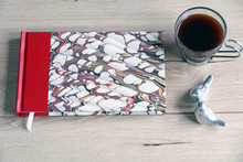 Notebook On Wooden  Table With Pen And Coffee