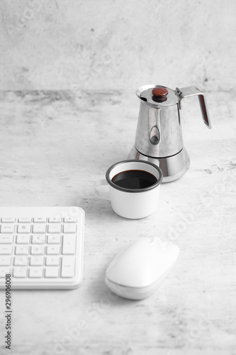 Fotografering Coffee in cup and computer on rustic table with a blank space for a text, Espres