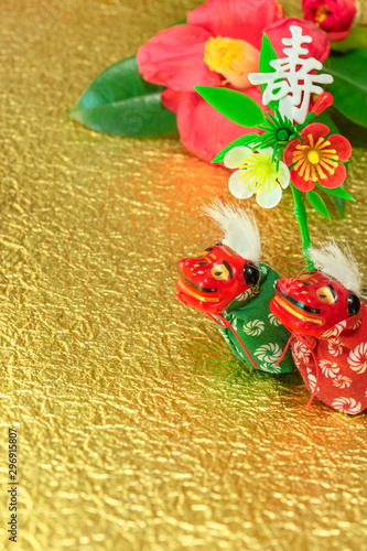 greeting card with a Tsubaki flower and two adorables Japanese Folklore animals Fototapet