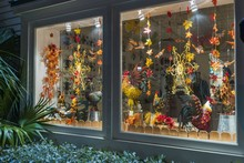 Beautiful View Of Shop Window. Colorful Figures Of Roosters And Butterflies , Leafs And Flowers As Decoration. Key West. Florida. USA.