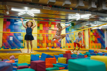 Little Children Having Fun On Kids Trampoline