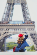 Young Woman With Long Blond Curly Hair In Paris, France